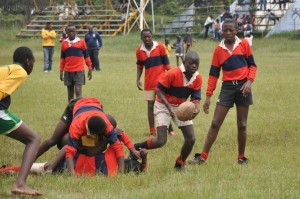 Kids playing Mtaa rugby.
